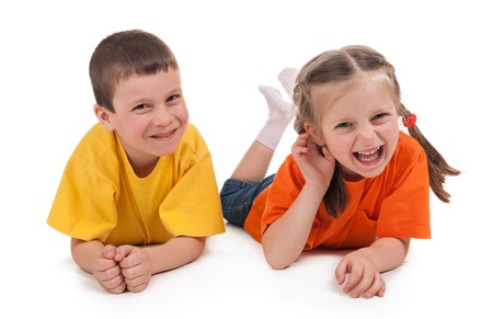 smiling boy and girl on white photo