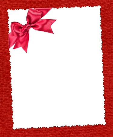 blank paper sheet with red bow on red textile photo