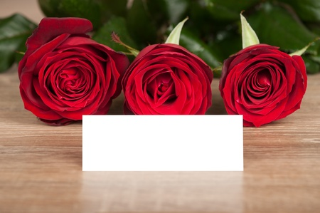 red roses and white sheet on wood photo