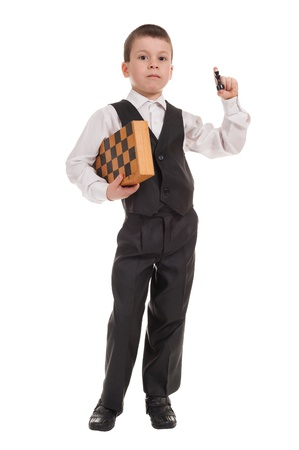 boy in black suit with chess isolated photo