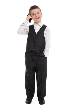 boy in suit talk on phone photo