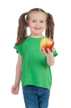 girl with apple isolated on white photo