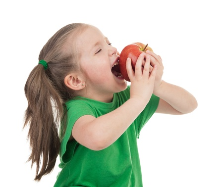 girl eat apple isolated on white photo