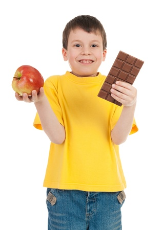 boy with apple and chocolate  on white photo
