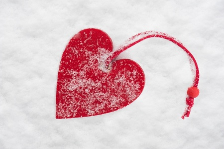 one red heart covered by snow  Stock Photo