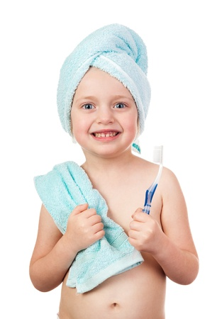 child in towel with toothbrush isolated photo