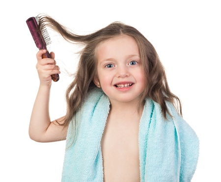 naked child: girl in towel combs her hair