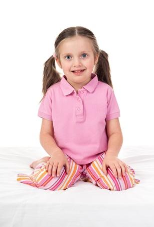 striped pajamas: ni?a alegre en ropa de dormir despertar Foto de archivo