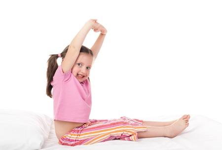 striped pajamas: cheerful girl in sleepwear wake up