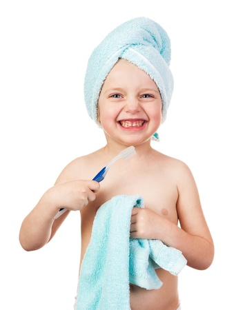 child girl nude: child in towel with toothbrush isolated Stock Photo