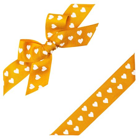 yellow bow with hearts and ribbon Stock Photo