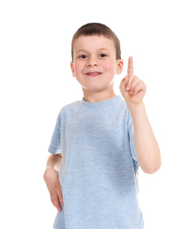 rollick: boy points finger up Stock Photo