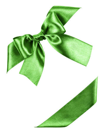 green bow made from silk ribbon isolated Stock Photo - 22379453