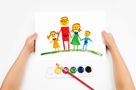 Child draws the family watercolors photo