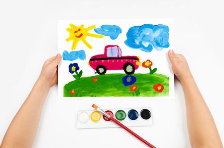car drawing: Child draws the car watercolors