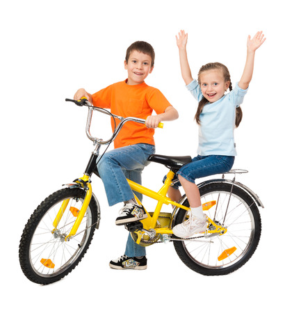 boy and girl on bicycle isolated on white