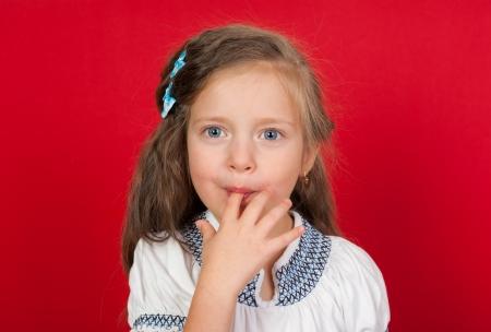 licking finger: girl licking her fingers