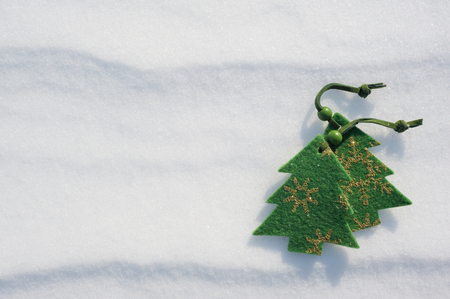 christmas green tree toys covered with snow photo