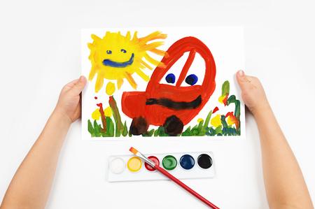Child draws the car watercolors photo