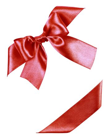 red bow made from silk ribbon isolated photo