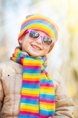 face in tree bark: girl in sunglasses in autumn park