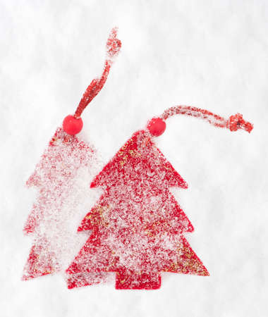 red christmas tree toy in snow photo