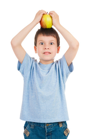 boy with apple isolated on white photo