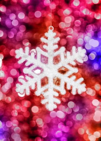 big snowflake toy on colorful background photo