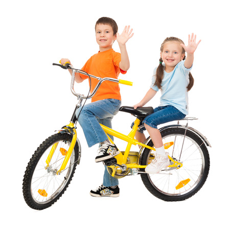 boy and girl on bicycle isolated on white photo