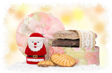 santa and honey cake in box with snow frame photo