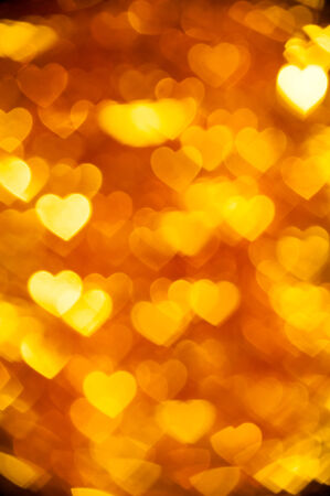 golden  heart shape holiday background photo