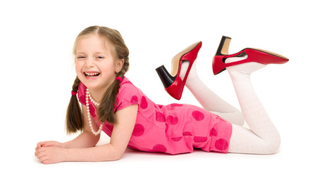 girl in a red dress and big shoes photo