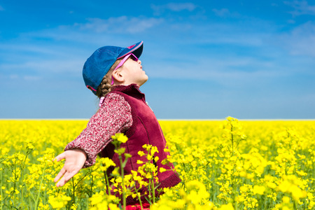 girl in a yellow field of rape. photo