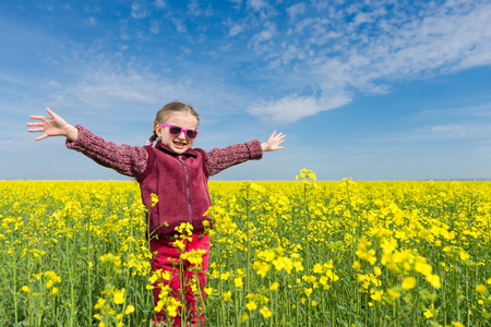 girl in a yellow field of rapeseed. photo