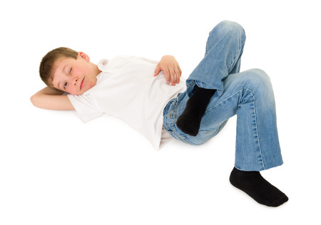 keek: boy lay on your back isolated on white Stock Photo