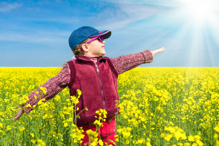 girl in a yellow field  photo