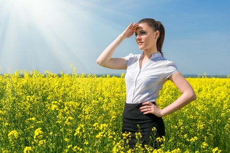 business woman at the yellow flower field photo
