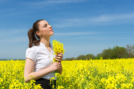 business woman with yellow flowers on the field photo
