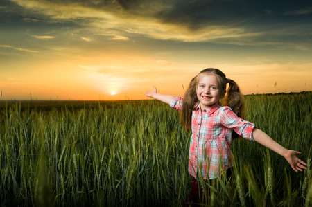 girl open arms at sunset photo