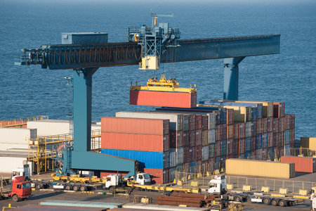 cargo container: lifting container in port