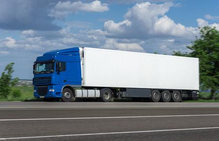 cargo truck go on road photo