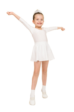 little girl dancing in a white ball gown photo