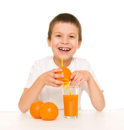 boy drink orange juice with a straw photo