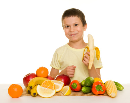 boy with fruits and vegetables photo