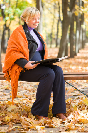 pregnant woman in autumn park photo