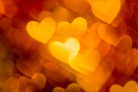 red and golden hearts bokeh background photo