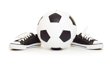 soccer ball and sport shoes on white isolated photo