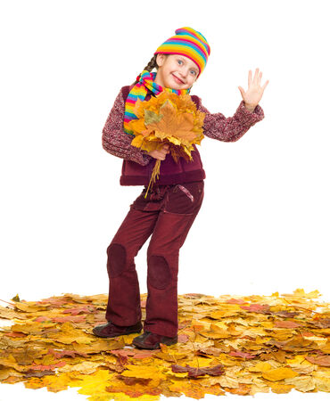 girl on autumn leaves studio shoot on white photo