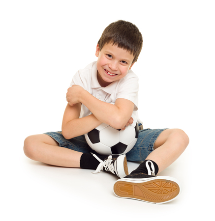 boy with soccer ball studio isolated photo