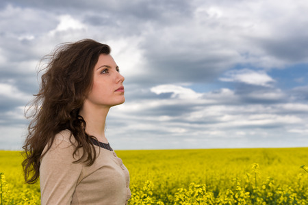 woman portrait in yellow flower field photo